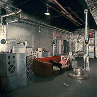 """Iconic portrait of Warhol on red sofa in his Silver Factory. First published in """"New York Herald Tribune"""" magazine, Agust 4, 1965. Taken with a 6x6 cm Haselblad."""