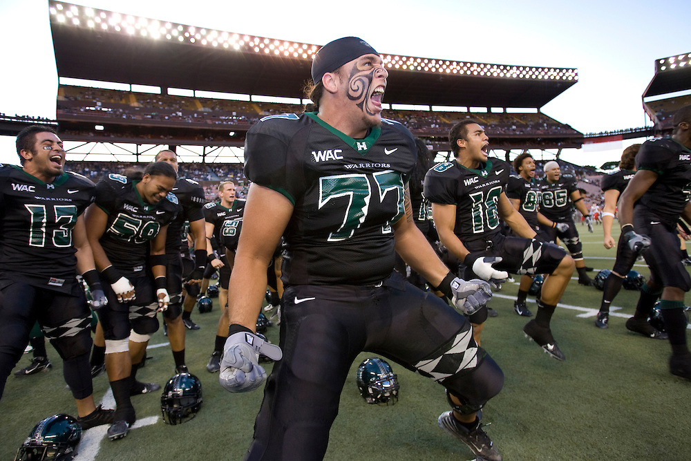 University of Hawaii football players perform a traditional Polynesian tribal chant.