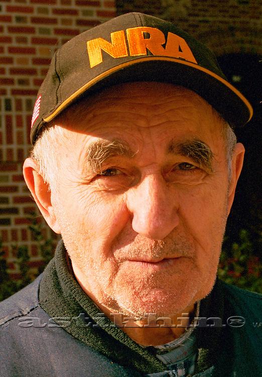 Portrait of friendly senior old male.