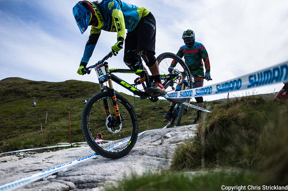 Nevis Range, Fort William, Scotland, UK. 3rd June 2016. British rider Sam Dale of GT Factory Racing tackles the course tape during practice. The worlds leading mountain bikers descend on Fort William for the UCI World Cup on Nevis Range.