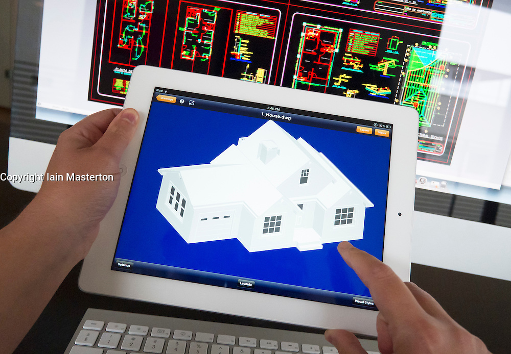 Architect Using Ipad 3d Cad Computer Aided Design Application To Model 3d Layout Design Of New