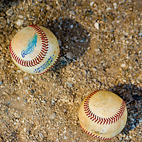 BRADENTON, FL -- May 21, 2012 --  Used baseballs collect wear in the the dirt during an inter-squad game at IMG Baseball Academy in Bradenton, Fla., on Monday, May 21, 2012.  (PHOTO/CHIP LITHERLAND)