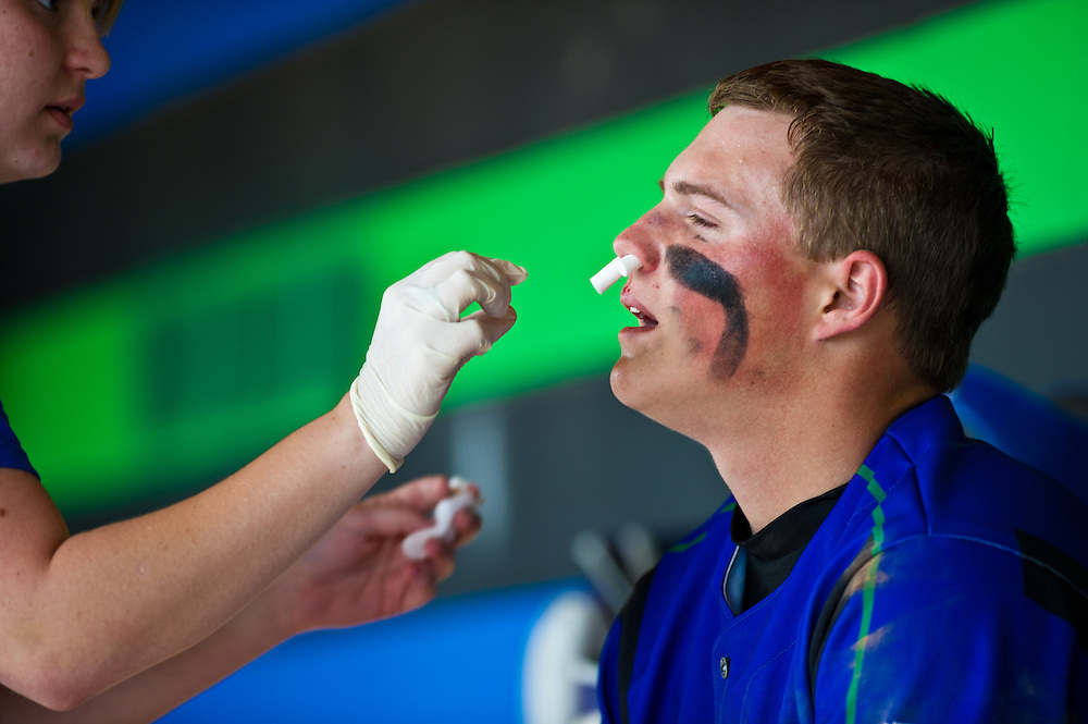 Injured varsity player gets attention to a bleeding nose