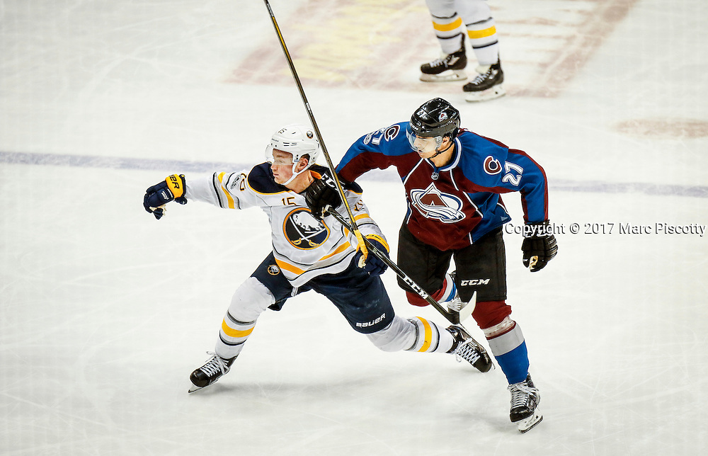 SHOT 2/25/17 10:23:26 PM - The Buffalo Sabres' Jack Eichel #15 battles the Colorado Avalanche's Andreas Martinsen #27 for position during their NHL regular season game at the Pepsi Center in Denver, Co. The Avalanche won the game 5-3. (Photo by Marc Piscotty / © 2017)