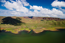 Sunken trees are evident in the shallows of Lake Argyle, a man made lake in the east Kimberley, eight miles inland from the Joseph Bonarparte Gulf.  The Agyle Dam is Australia's second largest man-make lake by volume.  The Ord River is the main body of water flowing into the dam, with secondary flow from the Bow River and other tributaries.  Construction of the dam was finished in 1971 and the dam was opened in 1972.