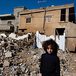 Nour Al-Akhrass visits the site where her cousin and other relatives were killed in the war between Israel and Hezbollah, Aytaroun, Southern Lebanon, Oct. 23, 2006.