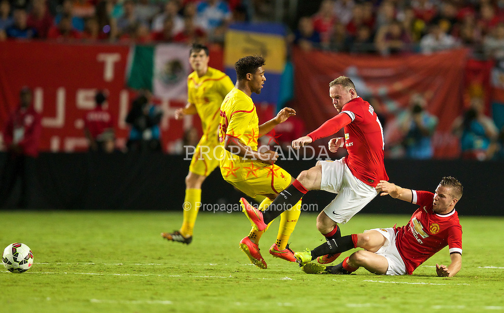 MIAMI, USA - Monday, August 4, 2014: Manchester United's Tom Cleverley tackles his team-mate Wayne Rooney during the International Champions Cup Final match against Liverpool at the SunLife Stadium on day fifteen of the club's USA Tour. (Pic by David Rawcliffe/Propaganda)