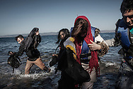 Refugees from Afghanistan and Syria arrive in boats on the shores of Lesbos near Skala Skamnias, Greece on 02 November, 2015. Lesbos, the Greek vacation island in the Aegean Sea between Turkey and Greece, faces massive refugee flows from the Middle East countries.