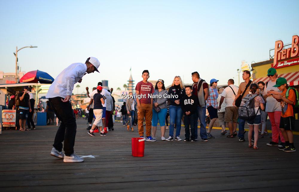 Street popping dancer performing in Santa Monica pier, California.