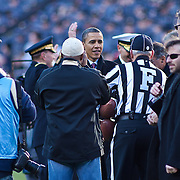 President Obama receives a game ball prior to the start of the 112th version of the Army & Navy rivalry this is the first Army-Navy game Obama has attended as Commander-In-Chief Saturday, Dec. 10, 2011 at Fed EX field in Landover Md. ..Navy set the tone early in the game as Navy defeats Army 31-17 in front of 82,000 at Fed EX Field in Landover Md