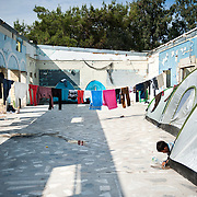 A washing line and tents inside the abandoned refectory of the old army camp in Moria, Lesvos, Greece