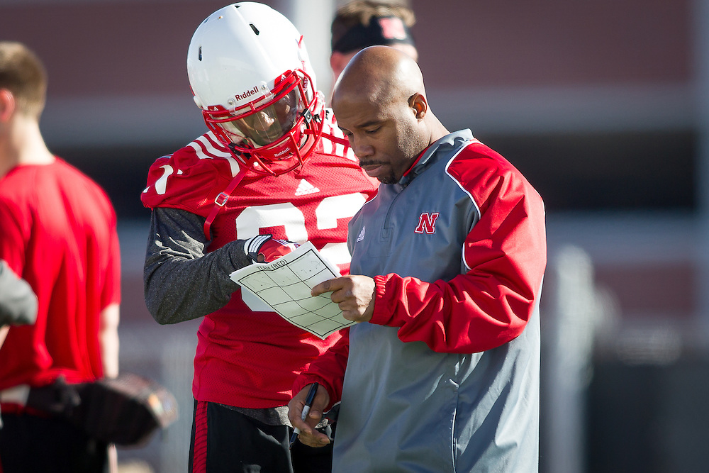 March 7, 2014: Receivers coach Keith Williams working with Alonzo Moore during the first spring practice at the Hawks Championship Center in Lincoln, Nebraska.