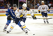 SHOT 3/28/15 9:00:07 PM - The Colorado Avalanche's Alex Tanguay #40 plays defense as the Buffalo Sabres' Matt Moulson #26 looks to shoot during their regular season NHL game at the Pepsi Center in Denver, Co. The Avalanche won the game 5-3. (Photo by Marc Piscotty / © 2015)