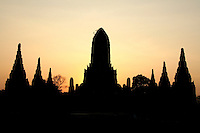 Wat Chaiwattanaram silhouette at sunset - one of Ayutthaya's most beautiful temples - construction began in 1630 at the request of King Prasat Thong for the memorial of his mother. The temple's name literally means the Temple of Long Reign and Glorious Era.