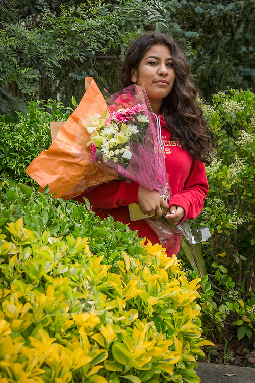 """Tenth grade Calistoga High School student Karina Hernandez returns from Calmart with Flowers for Mother's Day.  """"Today is Mother's Day in Mexico."""""""