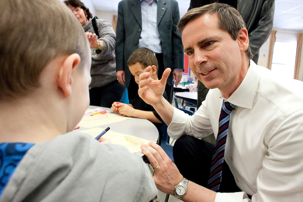 Ontario premier Dalton McGuinty speaks to kindergarten student Carson Bennett during a visit to Victor Lauriston School in Chatham, Ontario,  January 12, 2010, where he announced the details of the government's full-day learning program program for 4 and 5 year olds.<br /> CP Photo/ GEOFF ROBINS