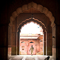 A man walks into the Jama Masjid, old Delhi just in time for prayers.