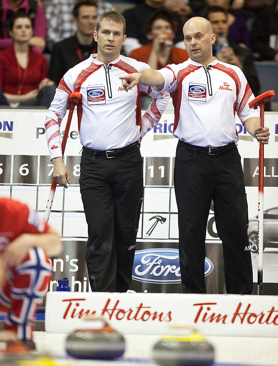 Canada's Skip Jeff Stoughton, left, talks with his third Jon Mead during their match against Norway in the evening draw at the Ford World Men's Curling Championships at the Brandt Centre in Regina, Saskatchewan, April 7, 2011.<br /> AFP PHOTO/Geoff Robins