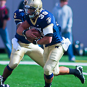 Navy QB (#4) Ricky Dobbs FB (#39) Alexander Teich for a first down. Navy defeats Notre Dame 35-17 at The New Giant's Stadium in East Rutherford New Jersey