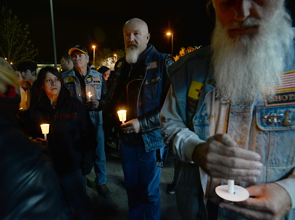 apl032717g/ASECTION/pierre-louis/JOURNAL 032717<br /> From left Michelle Montoya,, K.C. Willis, , and Palomino,,  mourn their friend  Earl &ldquo;Payaso&rdquo; Roybal,,at a candlelight vigil.  Roybal was fatally shot  while on a motorcycle ride with his girlfriend Sunday afternoon when he stopped at a west side car wash to clean his Harley Davidson.. Photographed  on Monday March 27, 2017. .Adolphe Pierre-Louis/JOURNAL