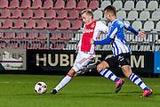 AMSTERDAM - Jong Ajax - FC Eindhoven , Voetbal , Jupiler league , Seizoen 2016/2017 , Sportpark de Toekomst , 24-02-2017 , Jong Ajax speler Donny van de Beek (l) in duel met Eindhoven speler Thomas Horsten (r)