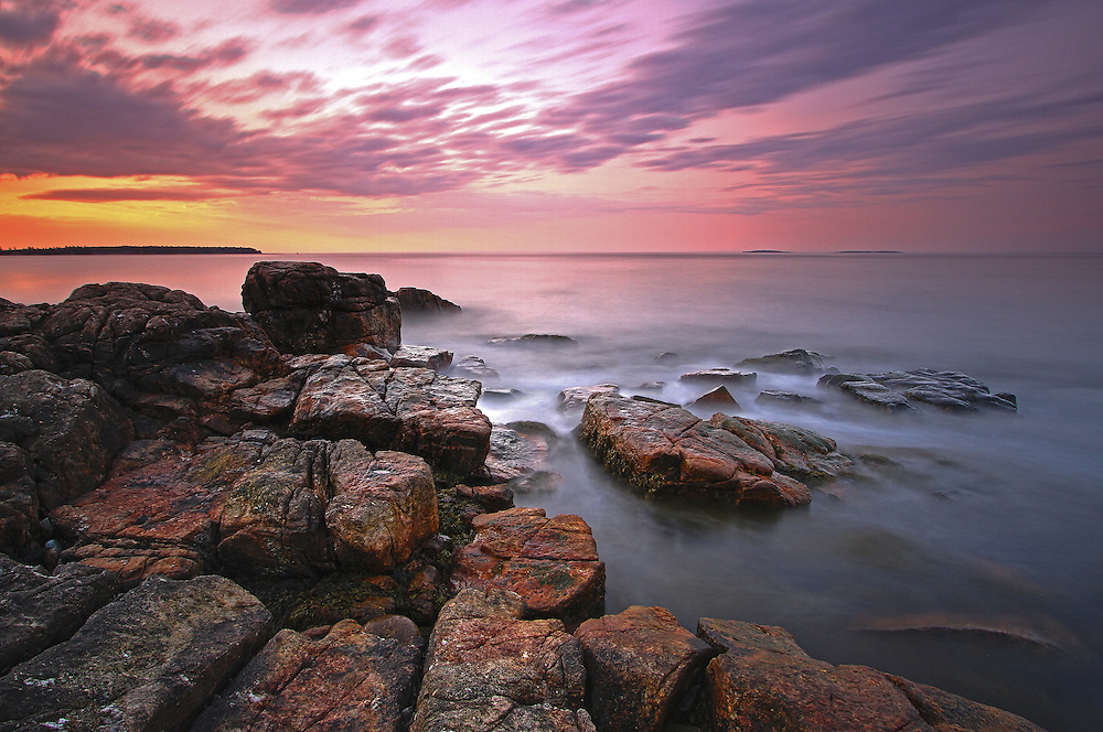 Coastal Maine photography image at sunrise of the rocky seascape and the Atlantic Ocean in Acadia National Park. Seawall is a naturally formed granite and rock seawall located on the southwestern side of Mount Desert Island in Southwest Harbor. I stayed nearby on my recent trip to Acadia and was able to head out early enough to capture the first light at this iconic Acadia NP location.  <br /> <br /> Downeast photography images of this sunrise picture are available as museum quality photography prints, canvas prints, acrylic prints or metal prints. Prints may be framed and matted to the individual liking and room decor needs:<br /> <br /> http://juergen-roth.pixels.com/featured/sunrise-at-seawall-maine-acadia-national-park-juergen-roth.html<br /> <br /> Good light and happy photo making! <br /> <br /> My best, <br /> <br /> Juergen<br /> Image Licensing: http://www.RothGalleries.com <br /> Fine Art Prints: http://juergen-roth.pixels.com<br /> Photo Blog: http://whereintheworldisjuergen.blogspot.com<br /> Twitter: https://twitter.com/naturefineart<br /> Facebook: https://www.facebook.com/naturefineart <br /> Instagram: https://www.instagram.com/rothgalleries