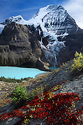 Mount Robson (3954 meters or 12,972 feet elevation), highest peak in the Canadian Rocky Mountains, rises above Berg Lake, in Mount Robson Provincial Park, British Columbia, CANADA. Ground foliage turns red in mid September. Berg Lake (1641 meters or 5385 feet elevation) has a beautiful turquoise color created by glacial sediments suspended in the water. Leaves of low-growing bushes have changed from summer green to a blazing red color in late September. Mount Robson is part of the Canadian Rocky Mountain Parks World Heritage Site declared by UNESCO in 1984. Published in Sierra Magazine, Sierra Club Outings January/February 2004.