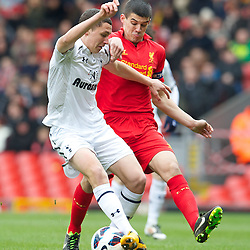 LIVERPOOL, ENGLAND - Easter Monday, April 1, 2013: Liverpool's captain Conor Coady in action against Tottenham Hotspur's Milos Veljkovic during the Under 21 FA Premier League match at Anfield. (Pic by David Rawcliffe/Propaganda)