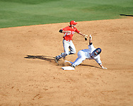 Ole Miss' Tanner Mathis (12) is forced out at second  vs. Houston's Jake Runts (13) at Oxford-University Stadium in Oxford, Miss. on Saturday, March 10, 2012. Ole Miss won 9-0.