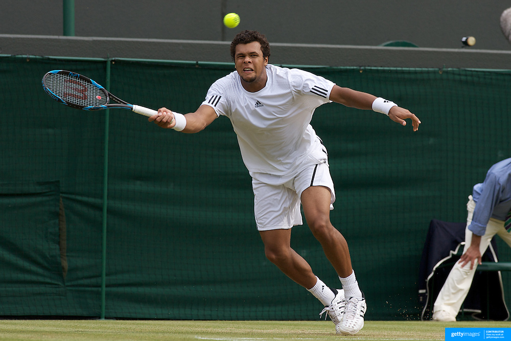 Jo-Wilfred Tsonga, France, in action against Ivo Karlovic, Croatia, during the third round of the Mens Single competition at the All England Lawn Tennis Championships at Wimbledon, London, England on Friday, June 26, 2009. Photo Tim Clayton.