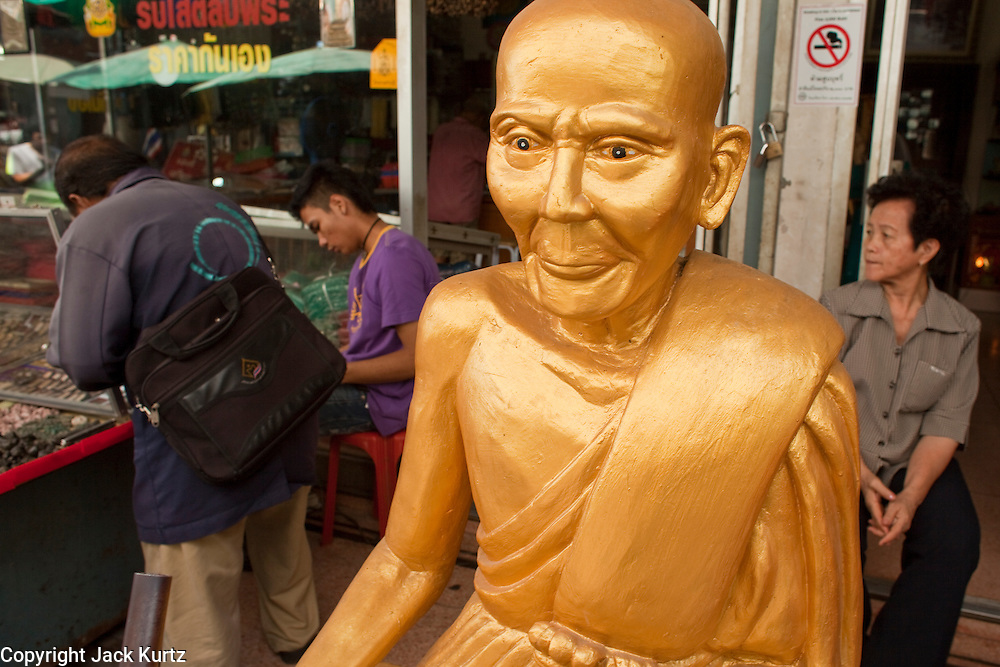 Mar. 7, 2009 -- BANGKOK, THAILAND:  A figure of a revered monk for sale in the amulet market in Bangkok, Thailand. The Amulet Market is adjacent to Wat Mahathat, between Maharat Road and the river. It is Bangkok's biggest amulet market, where a fantastic array of religious amulets, charms, talismans, and traditional medicine is sold. Photo by Jack Kurtz / ZUMA Press