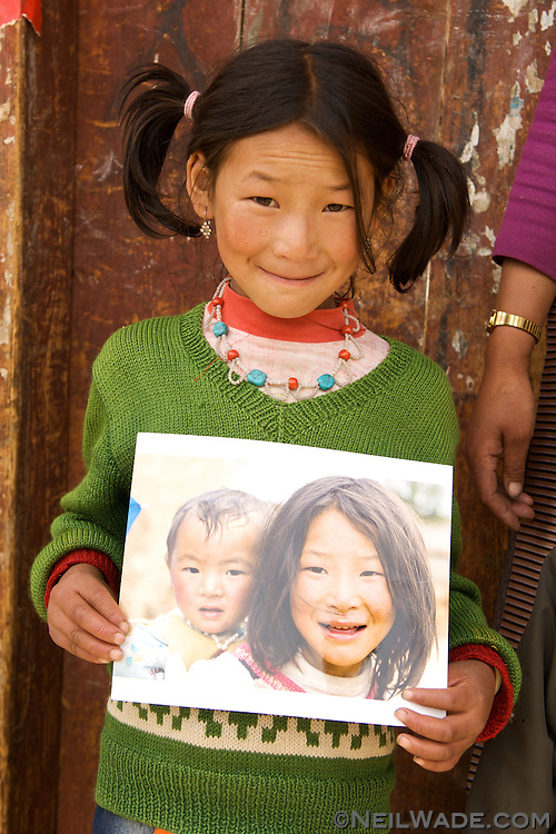 A fun thing I got to do the last time I was in Litang was visit people that I shot portraits of two years earlier and give back their portraits. It was great seeing everyone age two years, especially the kids.