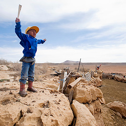 032713       Brian Leddy<br /> Logan Wilson waves his arms in the wind at his family's sheep camp near Bodaway Gap, Ariz. Wednesday afternoon. The family uses the camp in the winter months, which sits east of the Marble Canyon on the Colorado River.