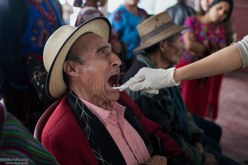 Francisco Cobo, 84, Ixil Mayan man from Nebaj, provides a DNA sample to members of the Forensic Anthropology Foundation of Guatemala (FAFG). Mr. Cobo hopes his DNA information will help identify the missing remains of his sons Diego and Jose, both disappeared during Guatemala's internal armed conflict. As of November 2014, the FAFG has positively identified the human remains of 77 war victims via DNA from the Ixil region. Nebaj, Quiché, Guatemala. November 5, 2014.