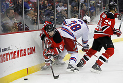 Feb 9, 2009; Newark, NJ, USA; New Jersey Devils defenseman Andy Greene (6) escapes a hit from New York Rangers right wing Colton Orr (28) during the third period at the Prudential Center. The Devils defeated the Rangers 3-0.