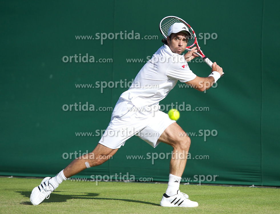 21.06.2011, Wimbledon, London, GBR, Wimbledon Tennis Championships, im Bild Fernando Gonzalez (CHI) in action during the Gentlemen's Singles 1st Round match on day two of the Wimbledon Lawn Tennis Championships at the All England Lawn Tennis and Croquet Club. (Pic by David Rawcliffe/Propaganda)