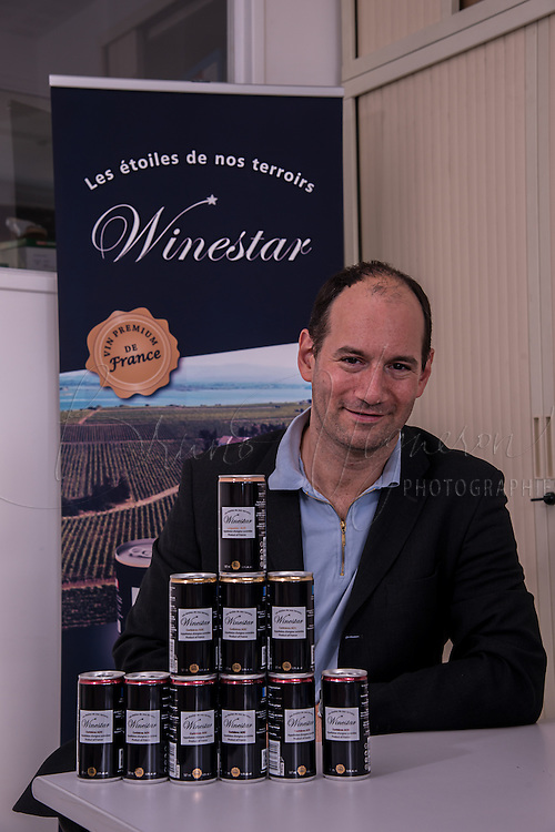 Paris, FRANCE - OCTOBER 02: Wine in cans<br /> Cedric Segal, CEO of Fabulous Brand.<br /> A domain in Beaujolais sells wine in cans under the new brand Winestar &reg; .<br /> The French company says to be able to commercialise in 2014 a Beaujolais wine in cans&nbsp;<br /> In recent months, Fabulous brand , based near Paris, has launched an innovative concept with Winestar &reg; : Three wines of Corbi&egrave;res are already packaged and distributed in the black cans (18.7 &amp; cl 2.50 euros sold at retail).&nbsp;<br /> A first in France<br /> According to Cedric Segal , the young CEO of Fabulous Brand, the can is the ideal packaging because it perfectly protects from air and light .<br /> Winestar uses a unique and patented technology , and is the one approved by the prestigious association &quot;Masters of Wine&quot;.<br /> This can is environmentally friendly. &nbsp;It is infinitely recyclable , with very little energy .<br /> Its lightness and compactness also generate a significant reduction of the carbon footprint. &nbsp;It can carry twice as much wine for the same weight / volume.&nbsp;<br /> Ultimate advantage: nevermore your wine will smell the cork, on October 2, 2013 in Paris, France. (Photo by Bruno Vigneron/Getty Images)