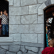 Children play while waiting in line to ride The Dragon roller coaster in Legoland in Whitehaven, Florida on February 11, 2012.