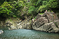 Relaxing alonr a river near Wulai, Taiwan.