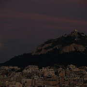 Athens at Dusk - full moon by Lycabettus hill
