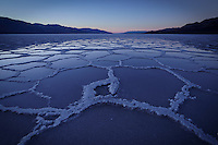 Twilight glow on flooded salt pan, badwater basin, Death Valley National Park, California, USA