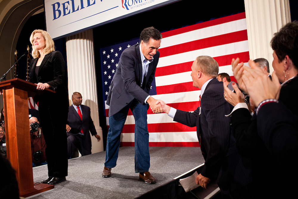 Republican presidential candidate Mitt Romney, joined on stage by his wife Ann Romney, holds a campaign rally on Tuesday, December 27, 2011 in Davenport, IA.
