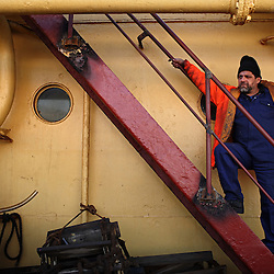 Seafarer Lazic Zoran stands on board the Alfa K, a Mediterranean based bulk carrier with a Panamanian flag, as it undergoes repairs at the port of Piraeus in Greece on Feb. 20, 2008. Inspectors impose ITF-standard treaties on ship-owners to guarantee minimal standard working conditions for seafarers. They are on call 24 hours a day to address concerns from workers coming to port on the international ships.