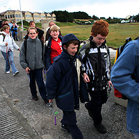 A group of school children return to class after an outing in Stanley, the capital of the Falkland Islands, on Wednesday, March 21, 2007. This year is the 25 anniversary of the war for sovereignty of the islands between the United Kingdom and Argentina. The two-month war resulted in the withdrawal of Argentinean forces and the islands remained part of the United Kingdom. After the war on the islands there has been strong economic development. (Photo/Scott Dalton)