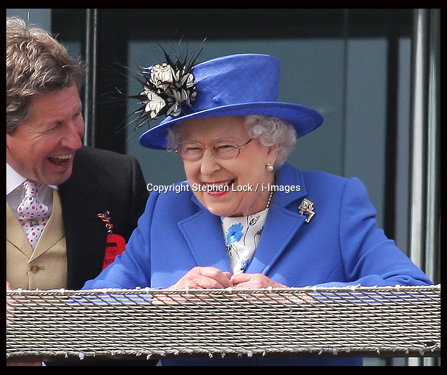The Queen  with her racing manager John warren at  the Epsom Derby, Saturday, 2nd June 2012.  Photo by: Stephen Lock / i-Images