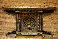 Peacock Window at  the Pujari Math, a formerly import ant Hindu monastery.  Renovated in the 70s with German aid, the building is now most famous for its peacock window, widely onsidered the finest carved window in the Kathmandu Valley.