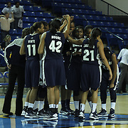 The lady Hoyas of Georgetown celebrates on the Blue Hens floor logo after defeating #11 Delaware  62-56 in the Quarterfinals of the Women's National Invitation Tournament Sunday, Nov. 11, 2012 at the Bob Carpenter Center in Newark Delaware.