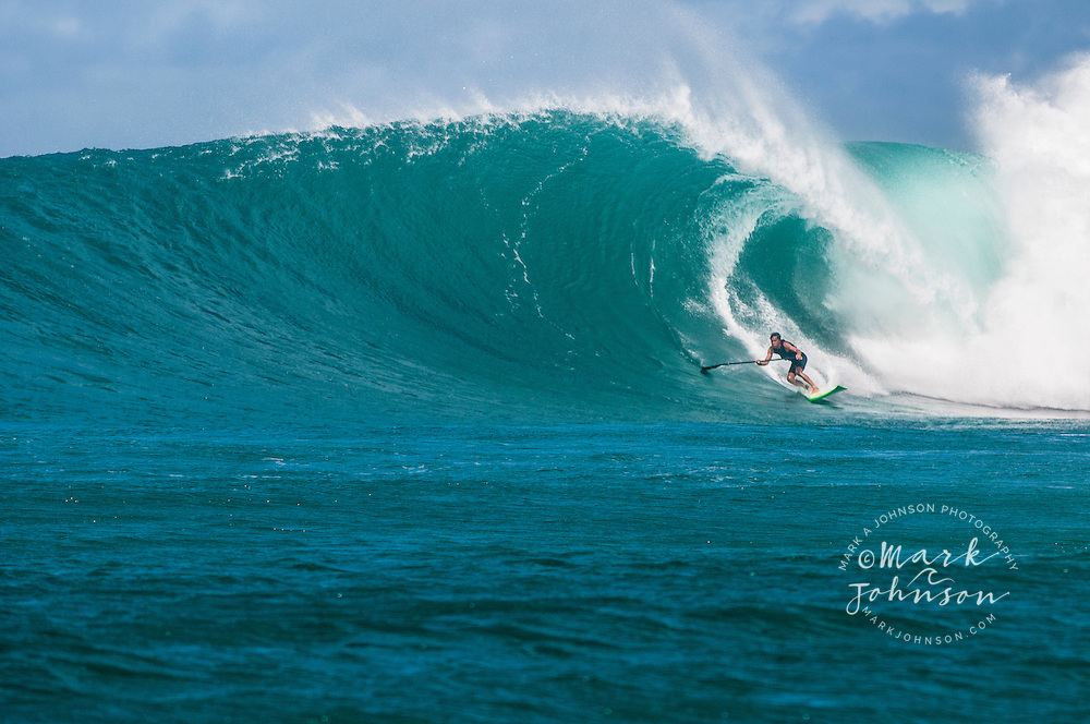 Above: Terry Chung, Stand-up Paddle Surfing a big wave in Hawaii