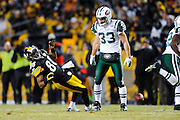 PITTSBURGH, PA - JANUARY 23: Emmanuel Sanders #88 of the Pittsburgh Steelers takes a late hit by Eric Smith #33 of the New York Jets in the AFC Championship Playoff Game at Heinz Field on January 23, 2011 in Pittsburgh, Pennsylvania(Photo by: Rob Tringali) *** Local Caption *** Emmanuel Sanders;Eric Smith