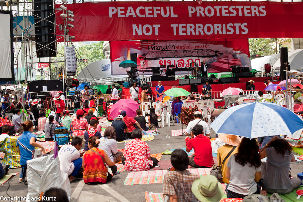 """May 12 - BANGKOK, THAILAND: The Red Shirt main stage in Ratchaprasong Intersection in Bangkok Wednesday. The Thai government said Wednesday that time has run out for """"Red Shirt"""" protesters in Ratchaprasong and Sala Daeng intersections in Bangkok and that a crackdown could come at any time. As news of the anticipated crackdown spread, Red Shirt protesters continued with an almost festive mood at their main stage but many of the sleeping areas around the protest site appeared to be empty. No official estimates on crowd size are available.  Photo by Jack Kurtz"""